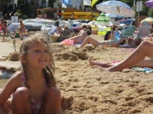 Building sandcastles makes Georgia smile
